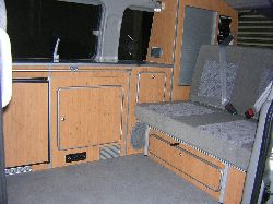 interior view of a mazda bongo showing seats and sink