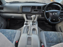 interior view of a car with steering wheel and nice seats