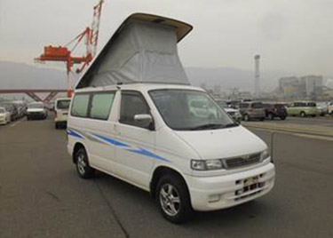 white car mazda bongo with roof up side view good value