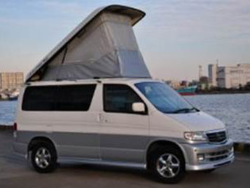 side view of a mazda bongo witht he roof up uk