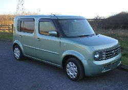 pastel green nissan cube