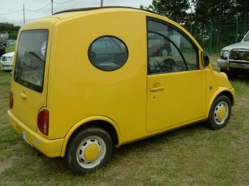 side view with porthole nissan escargot scargo algysa uutos japan car importer UK